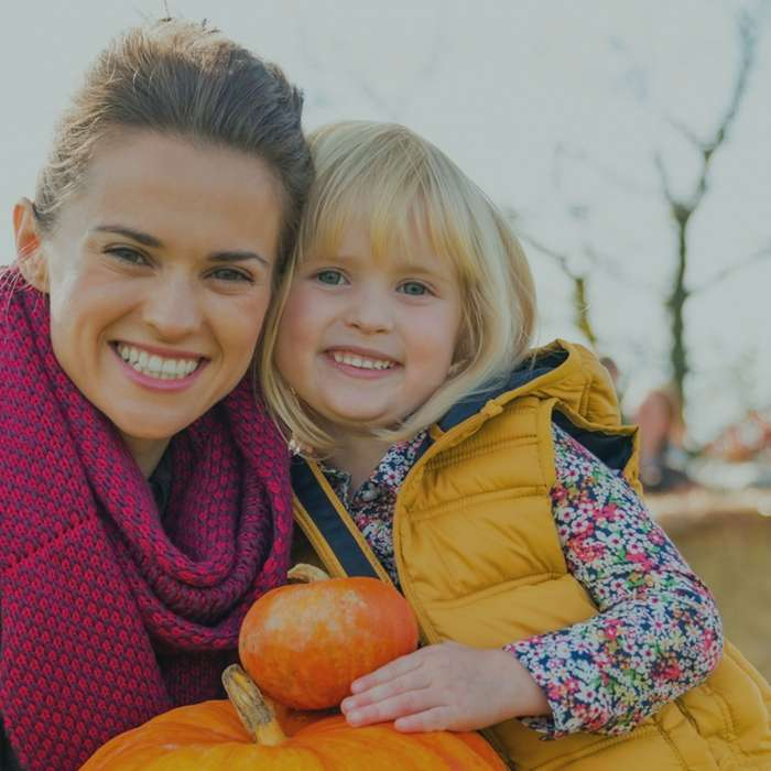 Mom and daughter with pumpkins